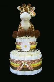 yellow and grey chevron baby shower cake with giraffe teddy bear