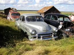 car yard junkyard old car salvage yards ot soviet junk yard ford truck