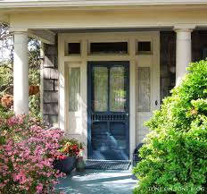 Blue House Orange Door Tone On Tone Storm Doors Ideas And Inspirations