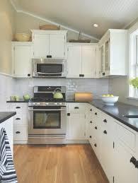 kitchen backsplash white cabinets black countertop regarding white