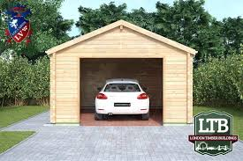 an old log cabin with attached one car garage and a dilapidated