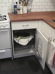 corner storage cabinets for kitchen swing out wire baskets in a