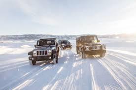 jeep snow jeep wrangler vs mercedes g550 vs toyota land cruiser comparison