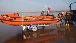 land rover rnli port talbot rnli lifeboat and rnli lifeguards assist woman on pier