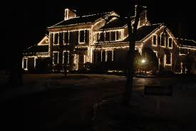 white lights on houses happy holidays