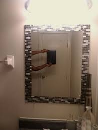 stick on frames for bathroom mirrors added strips of peel and stick tile to edge of mirror