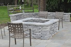 Unilock Fire Pit by Building A Gas Powered Fire Pit And Seat Walls With Rivercrest