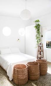 Minimalist Dorm Room Minimalist White Bedroom With Woven Baskets And Round Paper