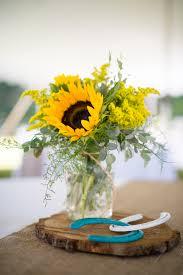 jar arrangements centerpieces of sunflowers in jars on wood slabs