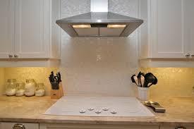 groutless kitchen backsplash of pearl tile backsplash