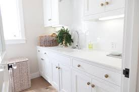 Laundry Room Cabinet Knobs White Laundry Room Cabinets With Brushed Brass Octagon Knobs