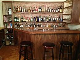 quirky home bar wall decor with classic wooden barstools within