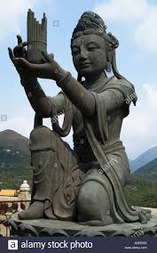 God Statue by Statue Of A God Or Immortal Praising The Tian Tan Giant Buddha At