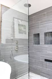 best 25 master shower tile ideas on pinterest master shower 12x24 tiles all the way to the ceiling with minimal grout lines via design