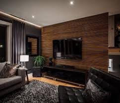 living room with striking wallpaper and simply wall mounted tv for