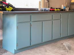 how to paint unfinished cabinets how to paint veneer cabinets for a lasting finish