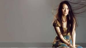 zhang ziyi in golden dress sad looking siting photoshoot wallpaper