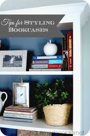 Styling Bookcases Styling Bookcases For A Much Used Family Room Mixing Pretty And