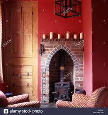 small wood burning stove a gothic shaped brick fireplace recess in