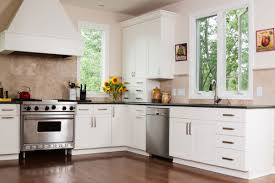 painting kitchen cabinets from wood to white 2021 cost to paint kitchen cabinets professional repaint