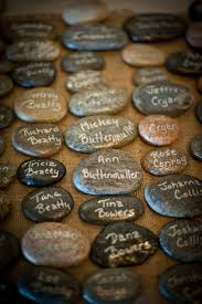 guest signing stones write with a marker that will show on shiny smooth rocks as a