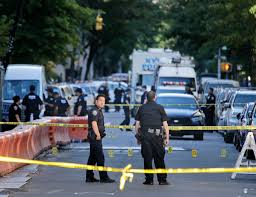 new york city cop fatally shot while sitting in police truck