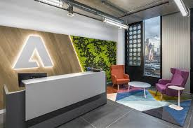 adobe s new london office features industrial yet colorful adobe image via businessinsider com the office s interior features colorful