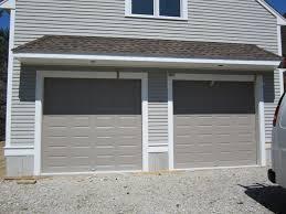 Western Overhead Door by Haas Model 680 Steel Raised Panel Doors In Sandstone Installed By