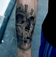 forearm skull tattoos black and grey realistic skull in clock tattoo on forearm by