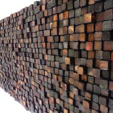 colored and burnt wooden wall sculpture smoke damaged stack