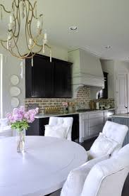 nook view to beautiful kitchen with vent hood and brick backsplash