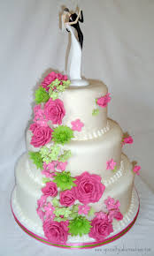 pink and lime green cascading flowers wedding cake cascading