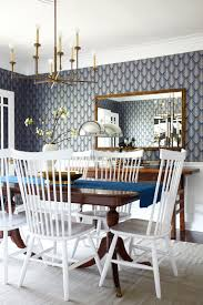 graphic blue wallpaper and brass accents in the lorey u0027s dining