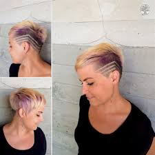 very short highlighted hairstyles women s eccentric blonde asymmetric pixie with shave detail and