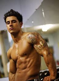 smiling man with right muscles tattoos in 2017 real photo