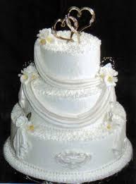 white fondant drapes medallions and calla lilies wedding cakes
