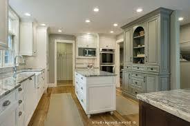 angled kitchen island ideas beige bevel stone tile backsplash