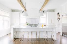 kitchen island counter stools white shiplap kitchen island with brass and lucite counter stools