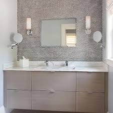 white and gray bathroom with white penny tiles finished with light