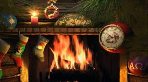 traditional christmas yule log fireplace with crackling fire