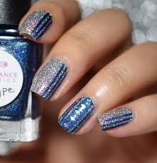 missbellatracey striped silver and blue nail art