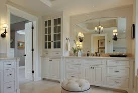 bathroom with footed cabinets and recessed lighting