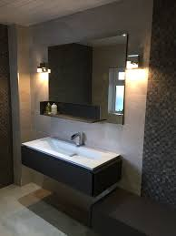 cool bathroom vanity design featuring stylish frameless mirror and