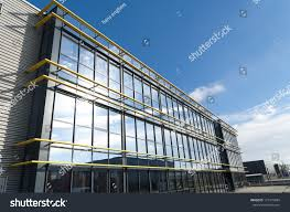 Building Exterior by Glass Exterior Modern Office Building Stock Photo 127479884