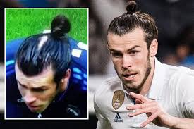 bale needs a hair cut gareth bale is fed up of using his famous man bun to cover his