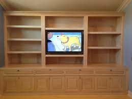floor to ceiling built ins with bookshelves and cabinets always