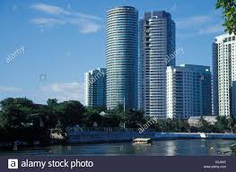 modern buildings on the manila river philippines stock photo