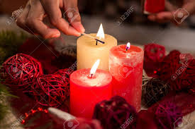 light up christmas candles child s hand lighting christmas candles close up of candles stock