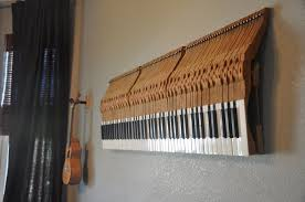piano key with white and black tuts on interesting wood