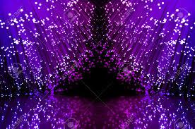 fiber optic light strands close up on two groups of illuminated blue and magenta fiber stock